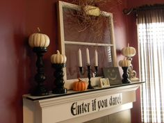 Halloween Mantel - Organize and Decorate Everything  Love the black candle stick holders with the white pumpkins!!