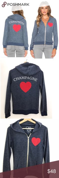 Chaser I ❤️ Champagne Hoodie Cozy up in this Chaser super soft zip up front hoodie with pockets. Great condition. Minor pilling due to nature of fabric. Screen print graphics with red heart on the front and showing your love for Champagne on the back. No cracking on graphics. Branded edges. See pics for more details. Chaser Tops Sweatshirts & Hoodies