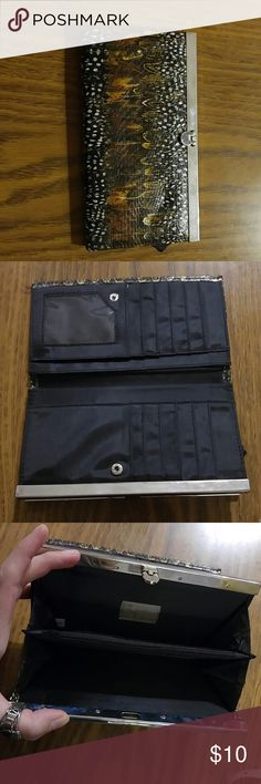 """Fancy feather wallet This is a cute wallet that can also be used as a clutch.  Looks like the maker is Mirror Mirror. It is hard to read. But this is in perfect shape. 7.5 """" long and 4"""" wide. Lots of pkaces to hold cards and money. Mirror Mirror Bags Wallets"""