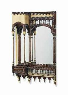 CARLO BUGATTI (1856-1940)  ARCHITECTURAL WALL MIRROR, EARLY 20th CENTURY  walnut, vellum, embossed copper, bone and pewter inlay  57 in. (144.8 cm.) high; 35 in. (88.8 cm.) wide; 12 in. (30.5 cm.) deep pae gbp 7-10