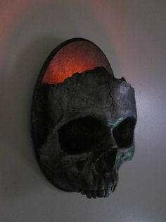 Haunting Gothic Skull Sconce Candle Holder-Dirty Steel Finish. $20.00, via Etsy.