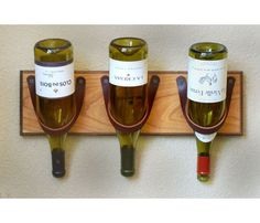 Leather Wine Rack, could look very modern with appropriate wood selection