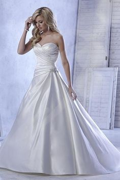 Balletts Bridal - 21792 - Wedding Gown by Jacquelin Bridals Canada - Silky tissue satin A-line gown with strapless sweetheart neckline and side-pleated bodice with beaded accent at waist. Pictured with belt style B075 as halter strap (sold separately).