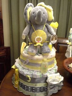 Yellow and Gray Elephant Diaper Cake, good for a girl or boy .Great gift for a Baby Shower or an expecting mother just as a gift. approx.. size 12x11 with a great price of $100.00.