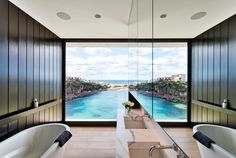 In this bathroom there's a view of the bay through the floor to ceiling window, and the bathroom mirror reflects the view making it seem even more dramatic.