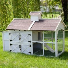 This coop looks just like a cottage that you'd find on a farm. It has four lockable barn-style doors and a cupola to match. Cottage Chicken Coop by Boomer & George. Chicken Coop Designs, Chicken Coops, Chicken Houses, Farm Chicken, Chicken Eggs, Bunny Cages, Cat Cages, Rabbit Cages, Keeping Chickens