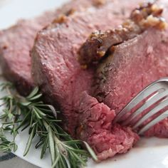 """A slow roasted Prime Rib recipe with step by step instructions and tips for how to slow roast a boneless or bone-in prime rib roast. This herb and garlic crusted prime rib is unbelievably easy to make and is sure to """"WOW"""" your dinner guests! Roast Beef Recipes, Rib Recipes, Cooking Recipes, Healthy Recipes, Beef Tenderloin Recipes, Game Recipes, Cooking Bacon, Smoker Recipes, Meatball Recipes"""