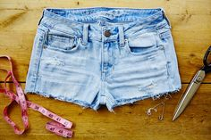 Don't throw your old jeans away just yet! How to turn your old jeans into shorts in just a few easy steps.