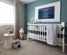 Nursery room design for a baby boy with DIY Twinkle Twinkle Little Star wall art, a grey chevron baby crib bedding set and rocket ship décor and lighting.