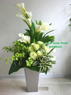 White Floral Arrangements Unique Flower Arrangements Flower Vases Floral Centerpieces Funeral Flowers Church Flowers Welcome Flowers Tall Flowers Memorial Flowers Tropical Flowers, Tropical Flower Arrangements, White Floral Arrangements, Funeral Flower Arrangements, Beautiful Flower Arrangements, Funeral Flowers, White Flowers, Beautiful Flowers, Cactus Flower