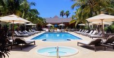 Save on booking hotels everywhere at Dames Hotel Deals International - Ports of Call Resort - Ports of Calls Grace Bay Road, Providenciales, Turks and Caicos Islands Turks And Caicos Providenciales, Best Travel Deals, Caribbean Vacations, Flight And Hotel, Cheap Hotels, Vacation Packages, Hotel Deals, Hotel Reviews, Central America