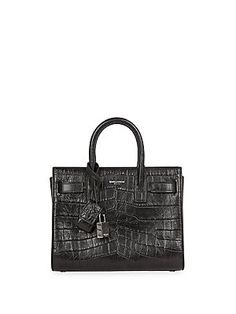 Saint Laurent Saint Laurent Nano Sac De Jour Crocodile Embossed Leather 0400088630568 Be The First to Write a Review Color:Black Pre-Order Expected ship date no later than: 03/14/2016 AED 8889.19