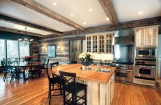 Stainless steel contrasts beautifully with hand hewn logs and heart pine flooring.