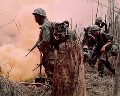 """Operation MacArthur: Members of Co. """"B"""", 1st Bn, 173rd Abn Bde, reach the top of one of the many hills in the highlands of Dak To, as yellow smoke bombs are set off for the spotter planes. 11/26/1967 - Vietnam War"""