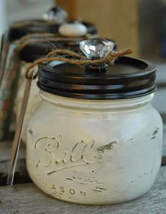 GORGEOUS Painted and distressed mason jars make for perfect storage. via www.littlehouseoffour.com