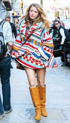Blake Lively wearing an amazing colorful printed coat by  Lindsey Thornburg and leather knee-high boots