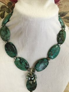 A personal favorite from my Etsy shop https://www.etsy.com/listing/219569361/green-african-turquoise-stone-necklace