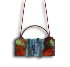 """Pendant  """"The River"""" from the """"Impossible Landscapes"""" series.  6 x 8 x 0.5 cm Oxidized nickel silver and enameled copper."""