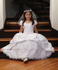 Lovely princess style communion or flower girl dress with pick up skirt and embroidered mesh adorns bodice & bottom of skirt. http://www.weddingaccents.com/accessories/ag-dr1575-princessstyle-communiondress.htm