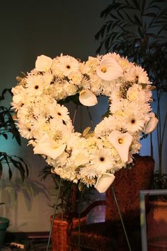Flower sprays, wreaths, and hearts are beautiful at a Celebration of Life Memorial www.eternallyloved.com