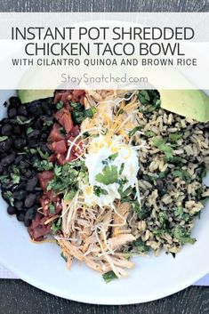 Instant Pot Shredded Chicken Taco Bowl with Quinoa and Brown Rice is a quick and easy recipe that takes less than 30 minutes to make. This bowl is topped with protein-filled Greek yogurt and cilantro. #instantpot #tacobowl