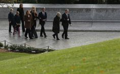 Members of the Kennedy family walk over to Robert and Edward Kennedy's gravesite to pay their respects at Arlington National Cemetery to mark the 50th anniversary of the assassination of former U.S. President John F. Kennedy at his gravesite in Arlington