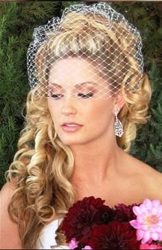 Birdcage veil, maybe a little bling/feather on the side