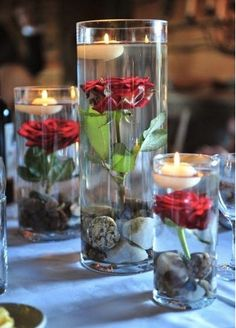 Floating Wedding Centerpiece: Putting one red rose with its stem in a tall, water-filled vase topped with a floating candle will give you a unique centerpiece. It's reminiscent of the rose from Disney's Beauty and the Beast, which inspires its own kind of magic.