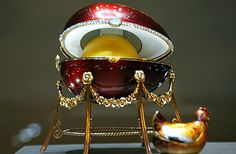 Hen Egg, the 1st Faberge egg, designed by Peter Carl Fabergé, Russia, 1885, as an Easter/anniversary gift for Maria Feodorovna, the wife of Tsar Alexander III (white enameled gold egg with golden yolk & small golden hen with ruby eyes inside). So began the yearly tradition of intricately detailed eggs, each unique, each containing a surprise, that continued until the Russian Revolution in 1917.