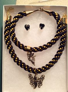 Elegant black and gold kumihimo necklace, bracelet and earring set with faerie pendants by DenverBeads on Etsy https://www.etsy.com/listing/200316677/elegant-black-and-gold-kumihimo-necklace