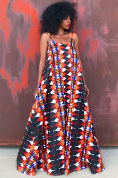 nigerian dress styles Cotton Chitenge A striking floral print in a modern maxi dress with a romantic flare. The perfect Spring Dress! The Margarita maxi features a flirty Nigerian Dress Styles, Ankara Dress Styles, Mode Wax, African Dress, African Wear, Afro, Halter Maxi Dresses, Cute Casual Outfits, African Print Fashion