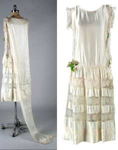 1920s Wedding dress. Ivory silk trimmed with lace and ribbons. Side snap closure; attached train. Via Mill St. Vintage/1st Dibs.