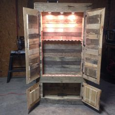 PALLET SHELVES PROJECTS Gun cabinet made from pallets. Could use chicken wire on the doors and add more shelves for a display case. Diy Pallet Projects, Wood Projects, Pallet Ideas, Pallet Designs, Pallet Crafts, Wood Crafts, Gun Cabinet Plans, Wood Gun Cabinet, Pallet Cabinet