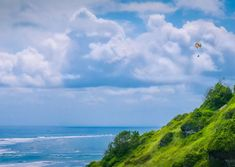 Paragliding from Bali's mountains and coastlines offer sweeping views of the island's diverse landsc... - Shutterstock