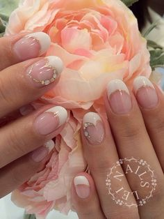 French manicure with gold heart detail