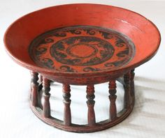 Antique Shan Burmese Lacquer Rattan Table  - A rare find, this low circular table known in Burma as kalat or daung -lan is from the mid-late 1800s and was crafted by the Shan of Burma. It is made from jackfruit wood and rattan and decorated with natural black lacquer and cinnabar pigmented red lacquer in a distinctly Shan design, resembling the crest of a wave in a circular pattern. The lacquer surface embellishment is textured and reflects light beautifully.