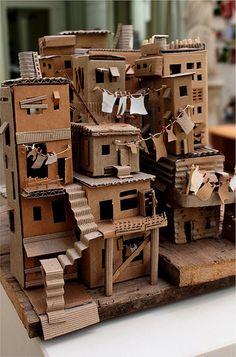 favela 3 // da trisbj - cardboard favela by pamela sullivan Cardboard City, Cardboard Sculpture, Cardboard Crafts, Paper Crafts, Cardboard Houses, Cardboard Mask, Cardboard Dollhouse, Cardboard Model, Cardboard Playhouse