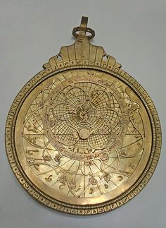 An 18th Century Persian astrolabe used for determining the time at both day and night. The points of the curved spikes on the front rete plate, mark the positions of the brightest stars. The name of each star being labeled at the base of each spike. The back plate, or mater is engraved with projected coordinate lines. From the Whipple Museum of the History of Science collection.
