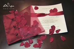 Red rose save the date, indian wedding invitation... hmmm... this packaging is a great idea.. instead of petals, leaves =)
