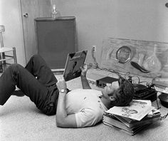 Clint Eastwood listens to records at home, October 1, 1959. Note the investment in hi-fi equipment and art over furniture. From CBS Photo Archive/Getty Images.