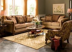 Gorgeous chenille upholstery and beautiful wood work.  Love the two-tone upholstery on the couch.  #RaymourandFlanigan