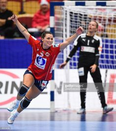 Norway's Nora Mork (L) celebrates after scoring a goal during the Women's European Handball Championship Group II match between Denmark and Norway in Helsingborg, Sweden on December 11, 2016. / AFP / JONATHAN