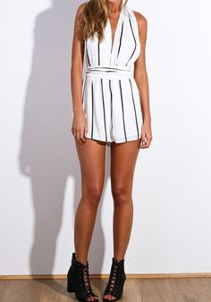 Full front view of model in striped romper and shoes