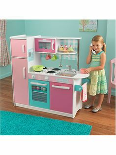 Ice cream shop colors make this Sundae Kitchen a sweet set for your preschool chef. This sturdy, composite wood kitchen is big enough for more than one kid cook - and that means an extra scoop of fun and a big dollop of creativity. Ages 3 and up. $179.99