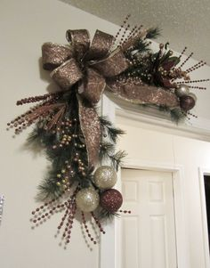 So many places these swags can go! Display over a picture, mirror, window, corner door or hang alone on any wall! These are made with pine and garland stems and has a beautiful gold and bronze ribbon, wired glittery poinsettia, glitter balls and other decor. As with all of my designs, I used only quality decor to create this wreath. These can be made in any 2 color combinations. Please read my reviews from other happy customers! Read the review on this item! Very good work as i...