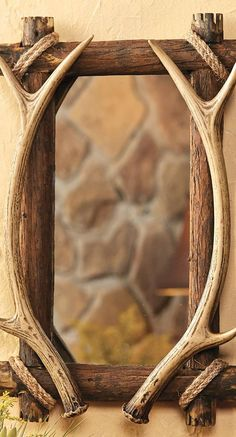 Graceful resin faux antlers and rugged rope details adorn the distressed wood frame of the Antler & Wood Mirror. This rustic mirror measures 14 x x 22 Rustic Mirrors, Wood Mirror, Western Decor, Rustic Decor, Rustic Wood, Rustic Bedroom Design, Rustic Bedrooms, Black Forest Decor, Antler Art