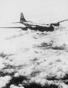 Bombs Away--Regardless of the type of enemy target lying in this rugged, mountainous terrain of Korea, very little will remain after the falling bombs have done their work. This striking photograph of the lead bomber was made from a B-29 Superfort of the Far East Air Forces 19th Bomber Group on the 150th combat mission of the 19th Bomber Group has flown since the start of the Korean war.