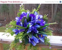 Blue iris and leaves in funky bouquet. I like this.