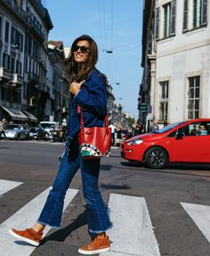 Chiara Totire in Joshua Sanders shoes with a Les Petits Joueurs bag