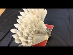 DIY: How to Make a Folded-Book Turkey. Have you ever wondered how we make all the book-page art you see at Cheshire Library? We convinced our Office Manager and Chief Book Artiste to demonstrate how she does it. This Folded Book Turkey is one of her Easy Christmas Crafts, Thanksgiving Crafts, Fall Crafts, Book Page Crafts, Book Page Art, Folded Book Art, Book Folding, Recycled Art Projects, Recycled Books